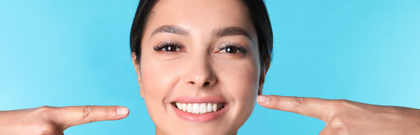 How Porcelain Veneers Can Beautify Your Smile for the Summer