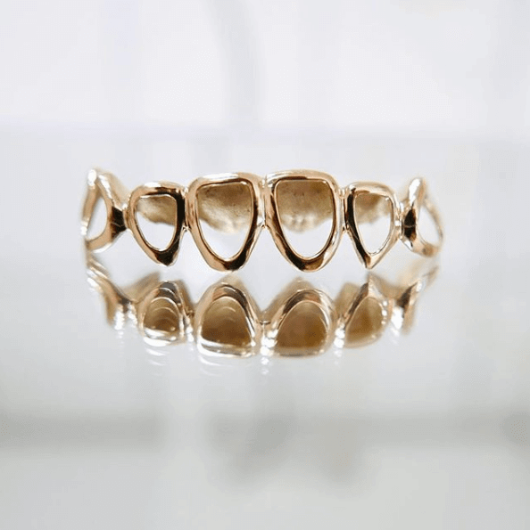 gold Grillz suspended in air